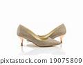 High heel of golden shoes. 19075809