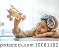 girl playing with toy airplane 19081192