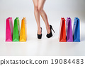 Female thin legs with colored bags 19084483
