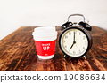 Alarm clock and coffee cup, Seven o'clock 19086634
