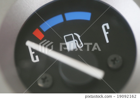 Stock Photo: Fuel gauge with warning indicating low fuel tank.