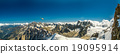 Panoramic view to a chopper flies over peaks 19095914