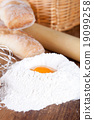 bread, flour, eggs and kitchen utensil 19099258
