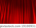 Red closed curtain with light spots in a theater 19100931