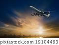 passenger plane flying on beautiful  dusky sky 19104493