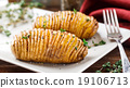 Baked hasselback potatoes  19106713