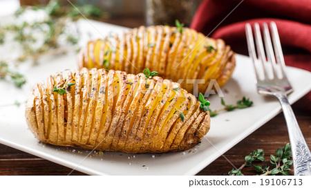 Baked hasselback potatoes  19106713