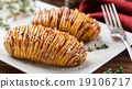 Baked hasselback potatoes  19106717