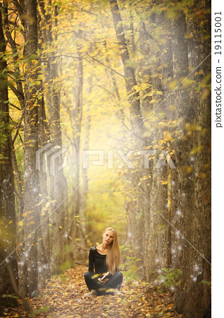 beautiful young girl in a magical forest a mysterious fairy tale halloween