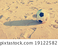 Vintage Soccer ball on sand 19122582