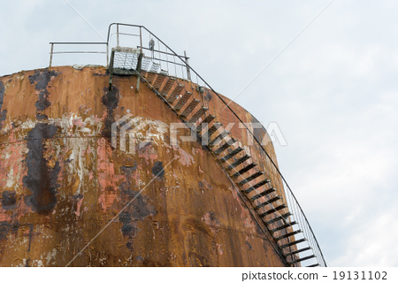 Stock Photo: oil reservoir rust cylinder metal tank sky stair