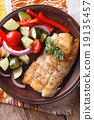 grilled fillet of fish and vegetable salad closeup 19135457