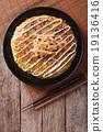 Japanese okonomiyaki on a wooden table. top view 19136416