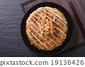 Japanese okonomiyaki pizza close-up top view 19136426