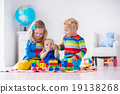 Kids playing with wooden toy train 19138268