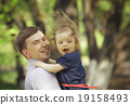 Dad plays with daughter 19158493