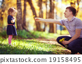 Dad plays with daughter 19158495