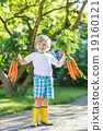 Happy little kid boy with carrots in domestic 19160121
