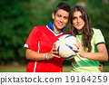 Two girl soccer players 19164259