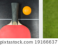 table tennis racket with ball on black table 19166637