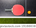 table tennis racket with ball on black table 19166638