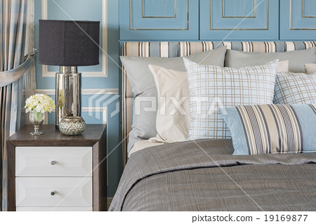 Stock Photo: classic lamp style on wooden table in blue bedroom