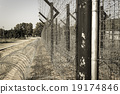 Old straight prison fence 19174846