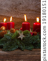 advent wreath with burning candles  19180151