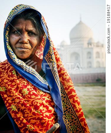 Stock Photo: Indigenous Indian Woman And Taj Mahal Backgroud Concept