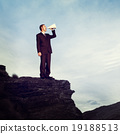 Businessman Shouting Megaphone Top Mountain Concept 19188513