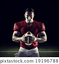 Composite image of american football player looking at camera 19196788