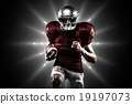 Composite image of american football player in red jersey runnin 19197073