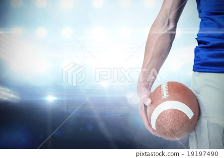 Stock Photo: Composite image of midsection of sports player holding ball