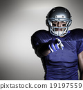 Composite image of portrait of american football player pointing 19197559