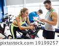 Fit people in a spin class 19199257