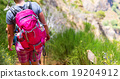 Woman with backpack 19204912