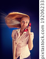 Woman with red telephone 19206233