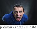 Agressive man in the dark 19207364