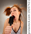 Housewife singing with a hairbrush 19207421