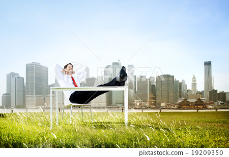 Stock Photo: Business Man Sitting Back Relaxing Outdoors Concept