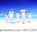 People performing yoga on the beach Peaceful Concept 19212329
