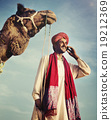 Indian Man On the Phone Camel Communication Concept 19212369