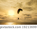 Silhouette of paraglider at sunset 19213699