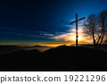Summit cross a mountain at sunset 19221296
