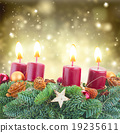 advent wreath with burning candles  19235611