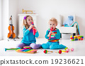 Boy and girl playing flute 19236621