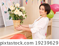 Young girl decorating her apartment for birthday 19239629