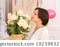 Young lady is smelling the flowers 19239632