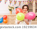 Young girl with colorful balloons 19239634