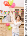 Young girl with colorful balloons 19239636